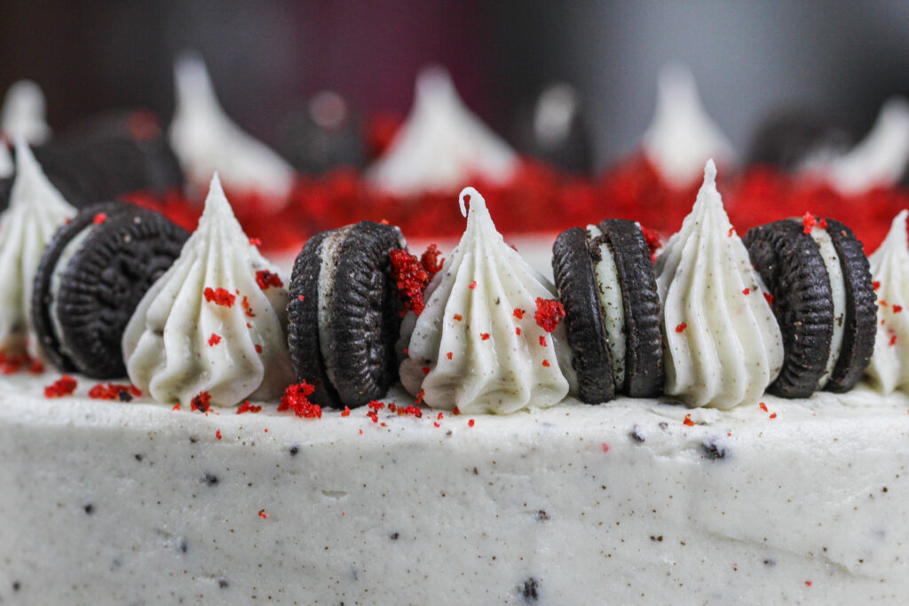 image of oreo cream cheese frosting piped on top of a cake