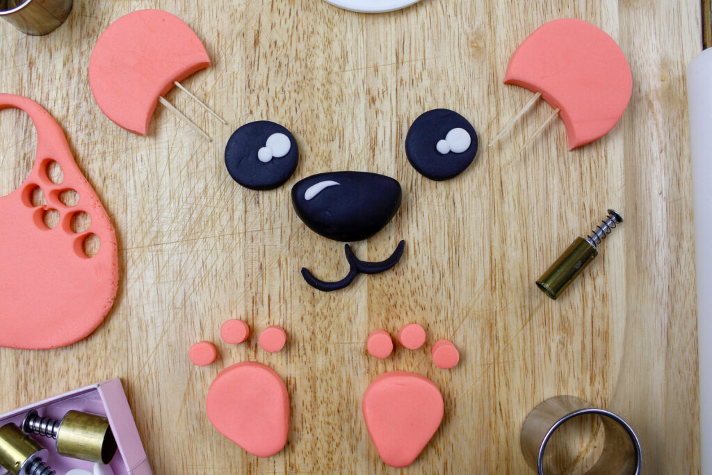 image of a fondant face and ears cut out to make a polar bear cake
