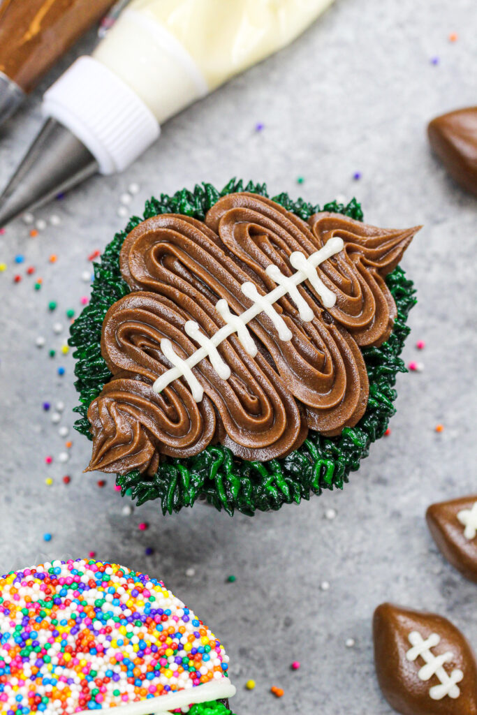 image of a football cupcake decorated with chocolate buttercream