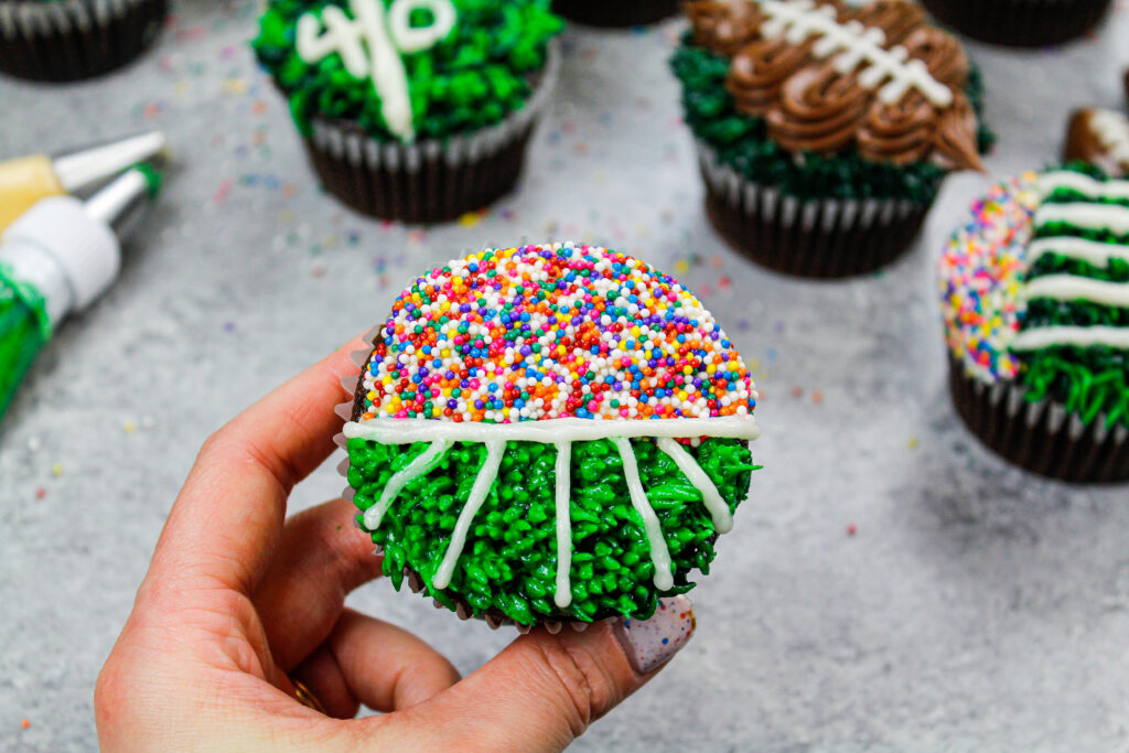 image of a football cupcake decorated to look like a football field with fans