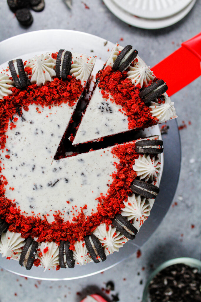 image of a red velvet oreo cake frosted with an oreo cream cheese buttercream