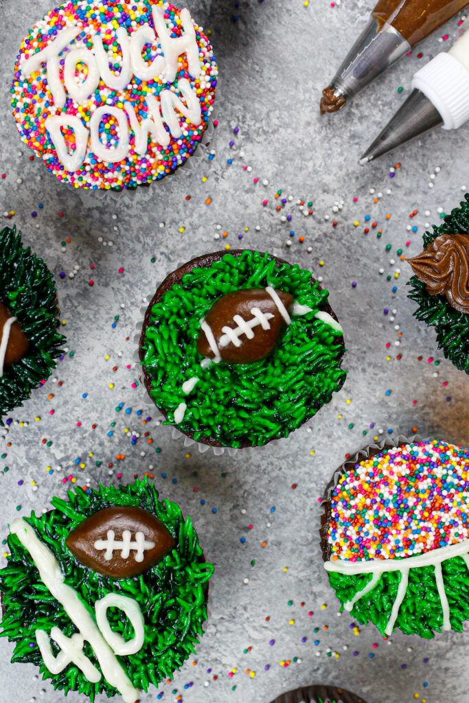 image of a football cupcake decorated to look like a football being thrown