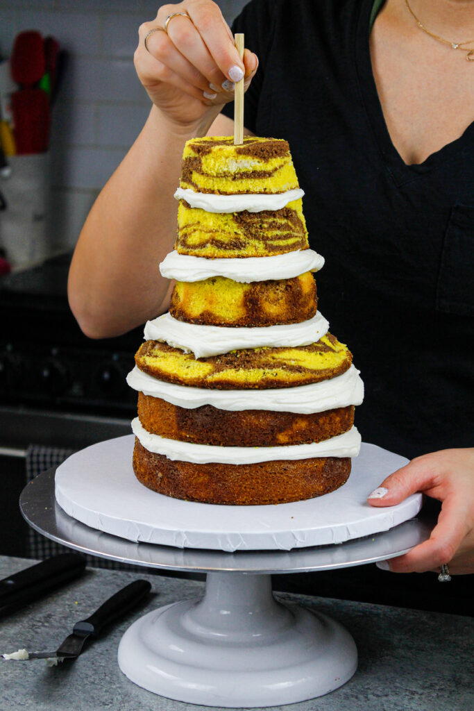image of yellow marble cake layers that have been stacked and trimmed to make a giraffe cake