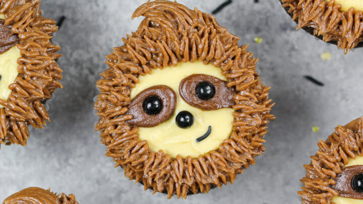 image of adorable sloth cupcakes made with chocolate cupcakes and chocolate peanut butter frosting