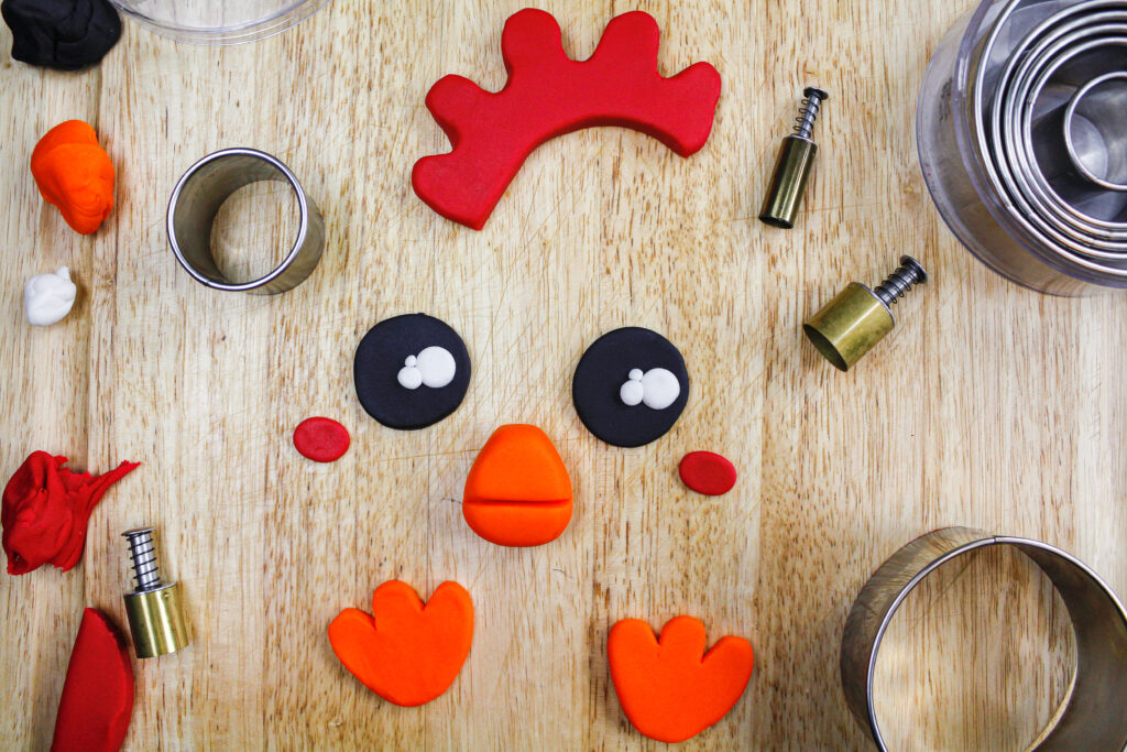 image of a fondant face cut out to make a chicken cake