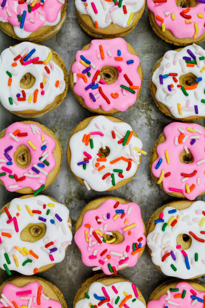 image of macaron shells that have been decorated with royal icing to look like little sprinkle donuts