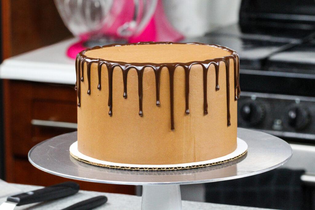 image of chocolate ganache drips added around a chocolate cake