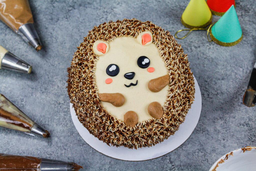 image of an adorable and easy to make hedgehog cake that's decorated with chocolate and peanut butter buttercream frosting