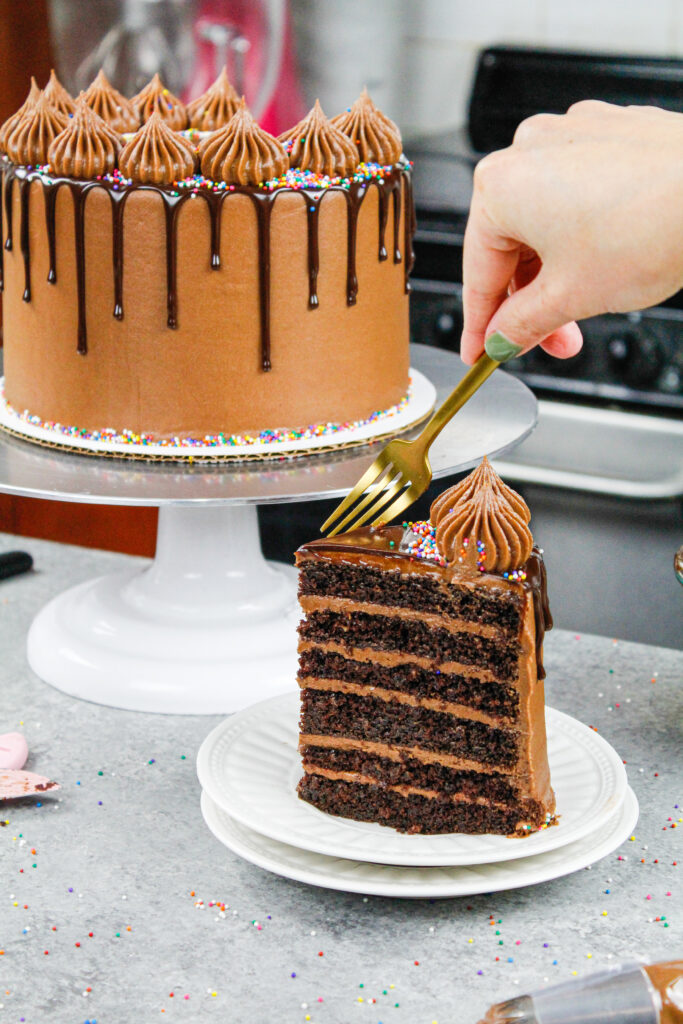 image of a chocolate drip cake made with moist chocolate cake layers and chocolate buttercream
