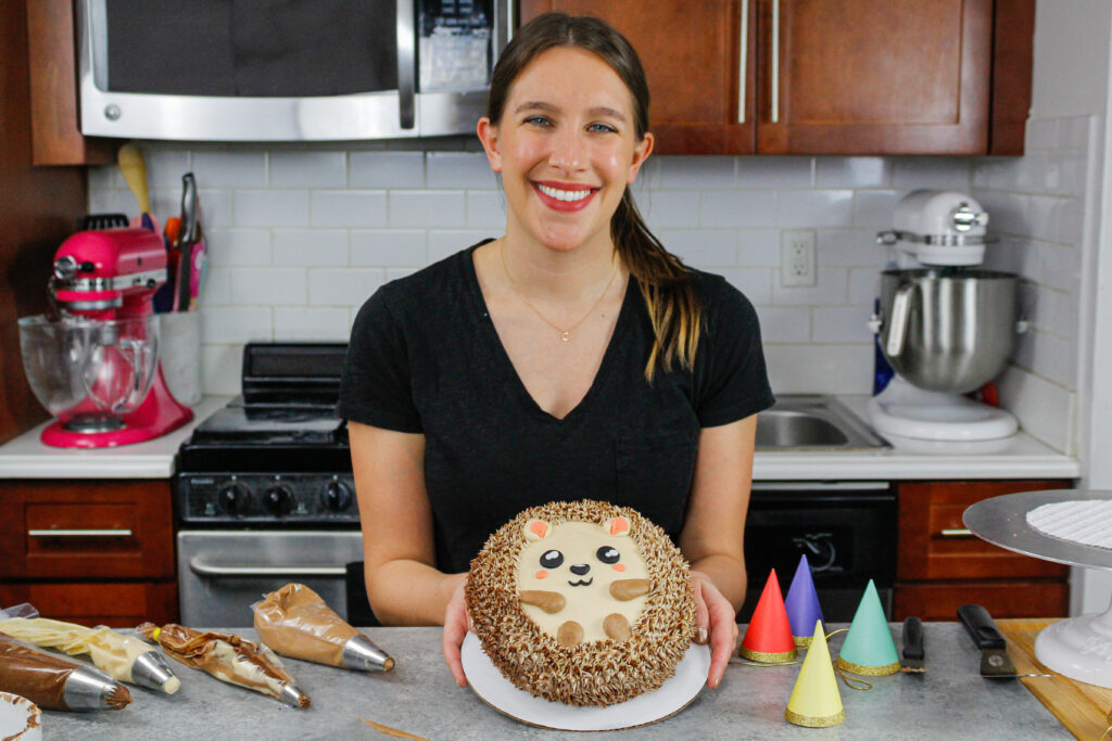 image of chelsey white of chelsweets with an adorable little hedgehog cake she made as part of her animal cake series