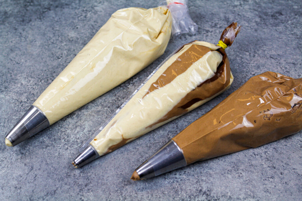 image of peanut butter chocolate buttercream frosting in piping bags