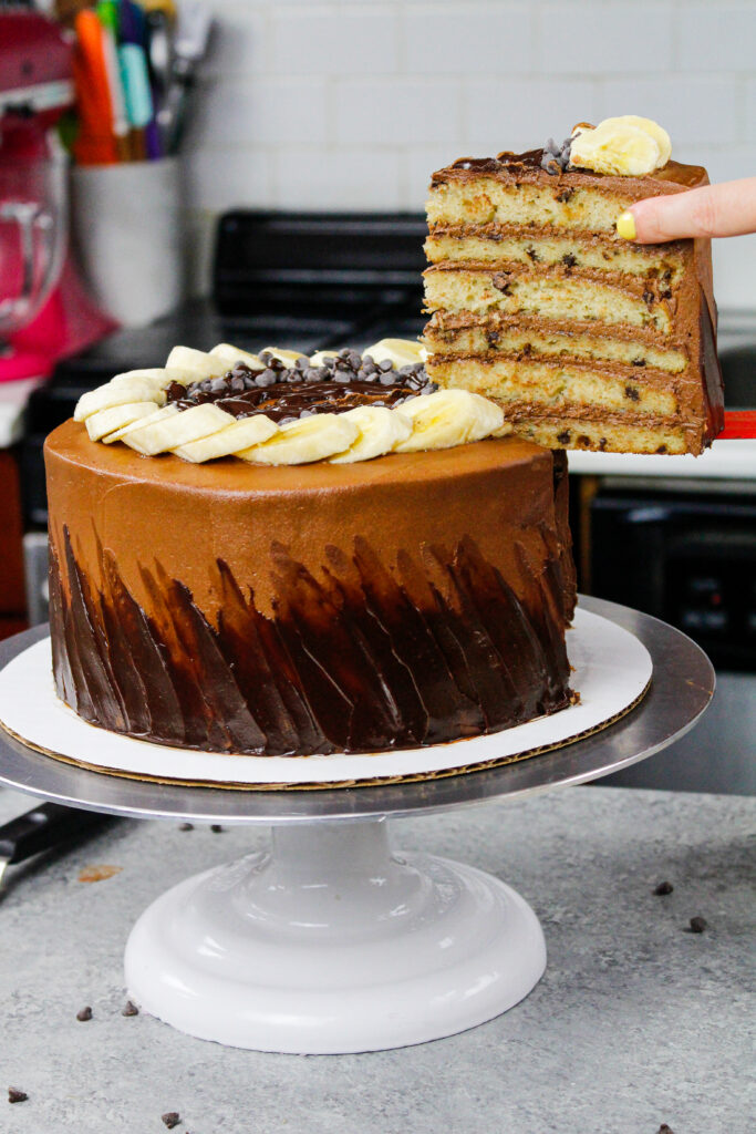 image of a chocolate chip banana cake made with banana cake layers and a fudgy chocolate buttercream frosting
