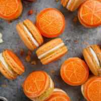 image of adorable orange macarons filled with orange marmalade and buttercream
