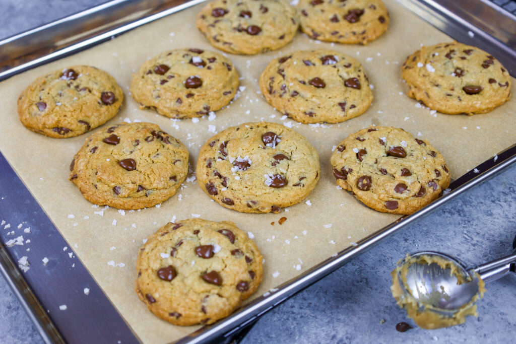 image of cream cheese chocolate chip cookies that have been baked until golden brown and sprinkled with flakey sea salt