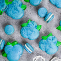 image of blueberry shaped macarons baked and filled with buttercream and blueberry jam