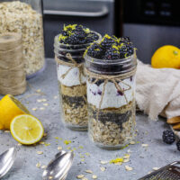 image of blackberry overnight oats made in advance in cute mason jars