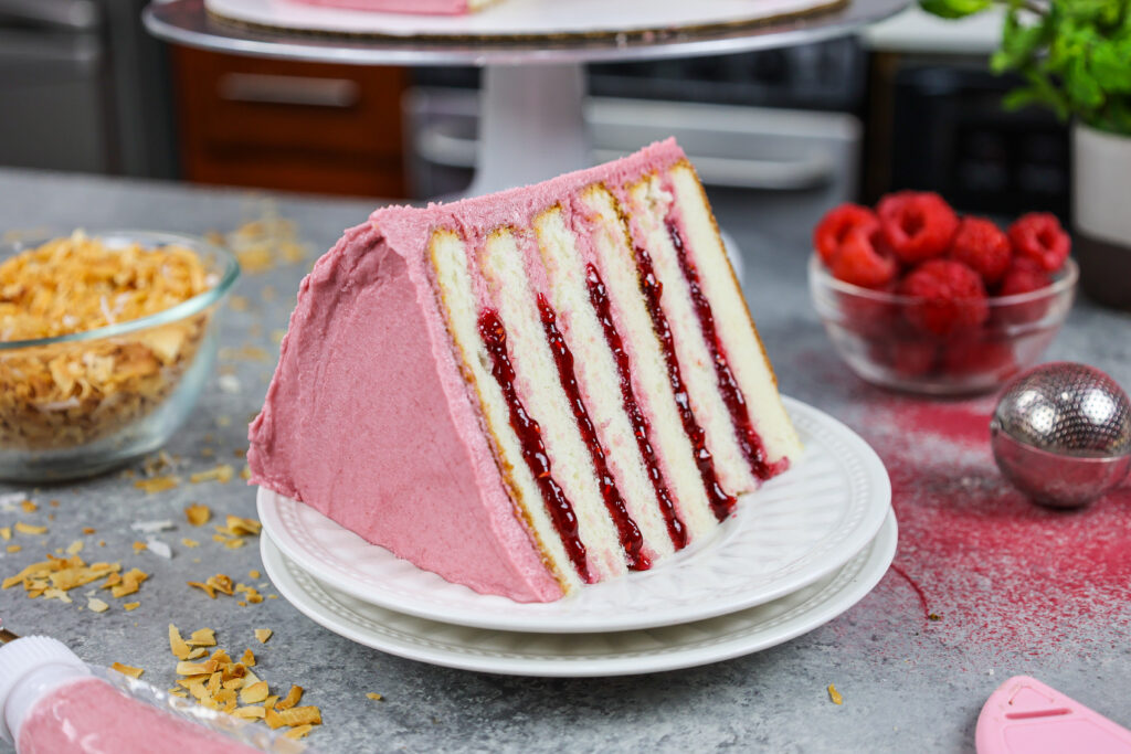 image of a slice of raspberry coconut cake on a plate