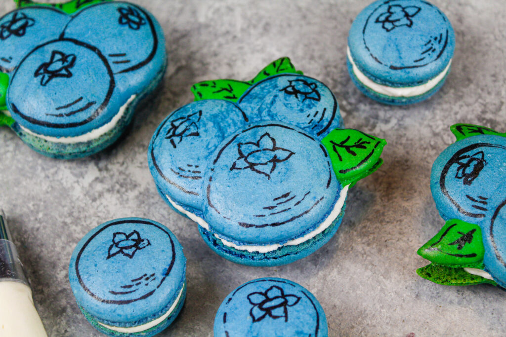 image of cute blueberry macarons that have been drawn on with edible marker