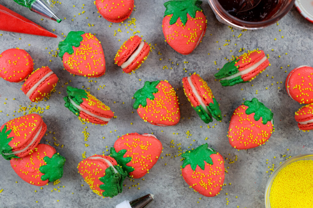 image of adorable french strawberry macarons filled with buttercream and strawberry jam