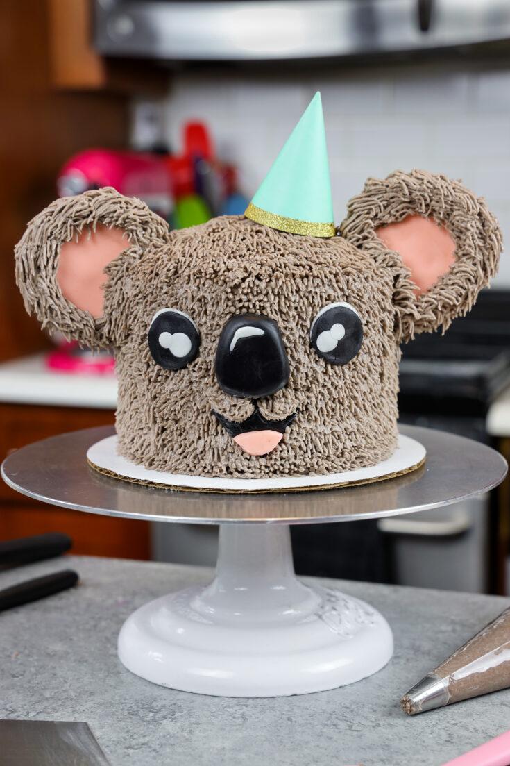 image of an adorable buttercream koala cake made with chocolate cake layers