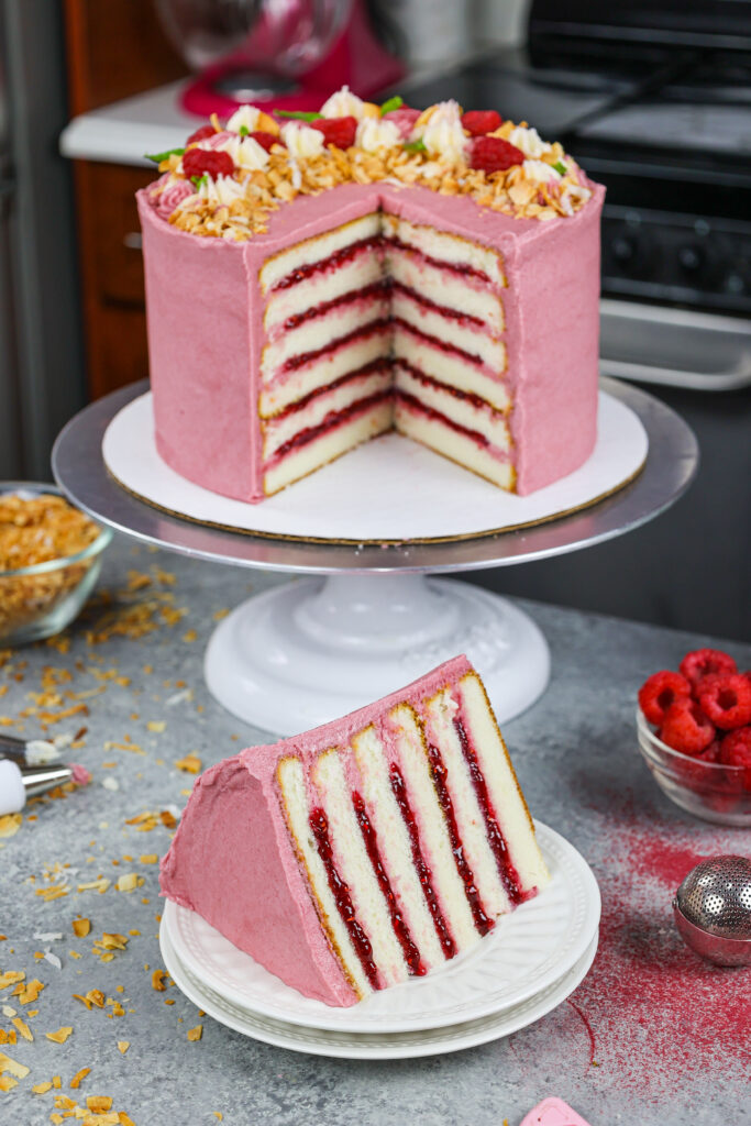 image of a raspberry coconut cake filled with raspberry jam