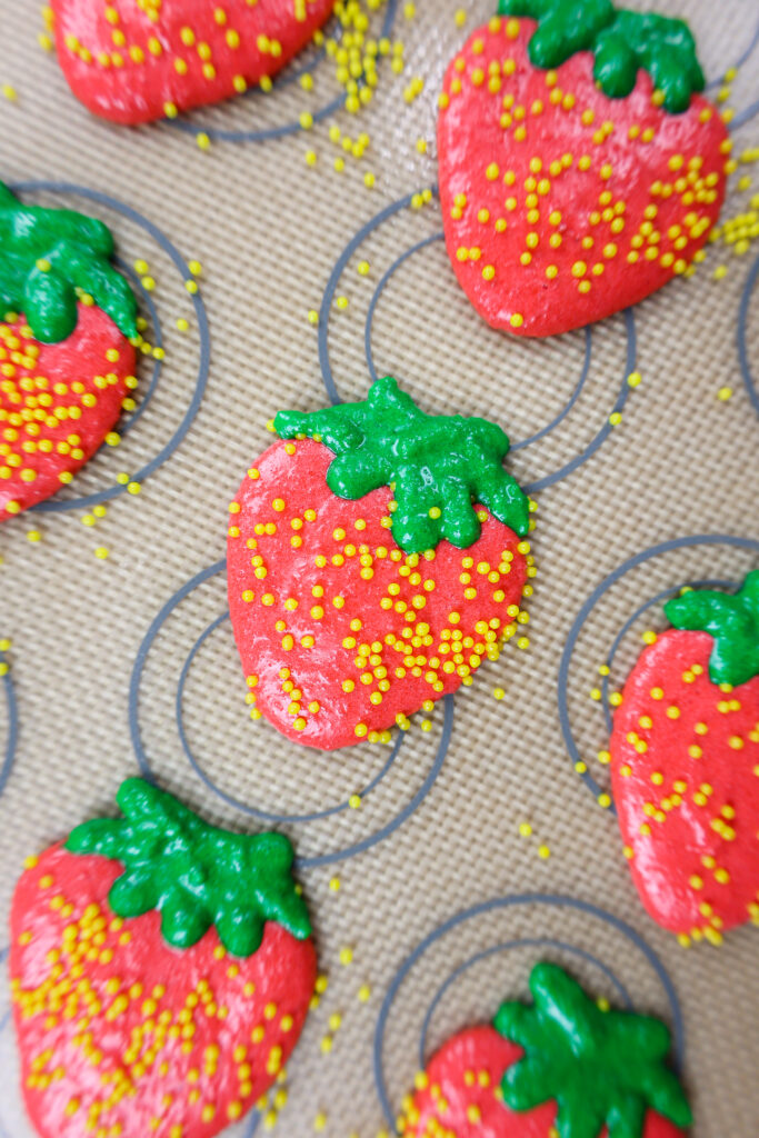image of strawberry shaped macaron shells resting before being baked