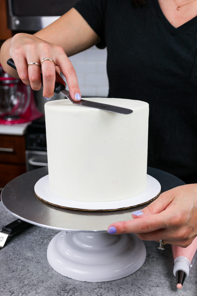 image a 6-inch layer cake that has perfectly smooth buttercream frosting
