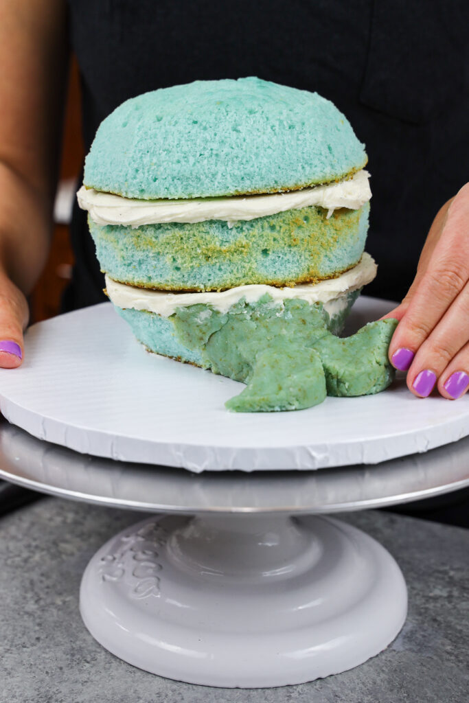 image of a cake ball mixture being used to a add a tail to a narwhal cake