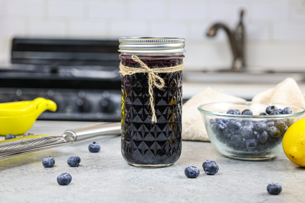 image of blueberry simply syrup poured into a mason jar for storage