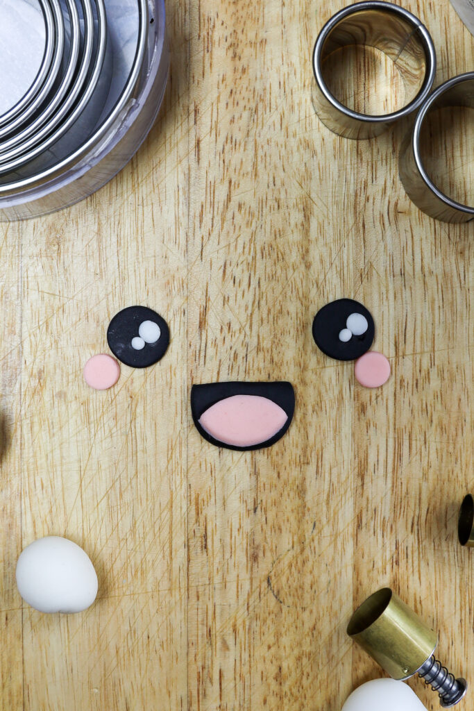 image of fondant cut out to make the face on a narwhal cake