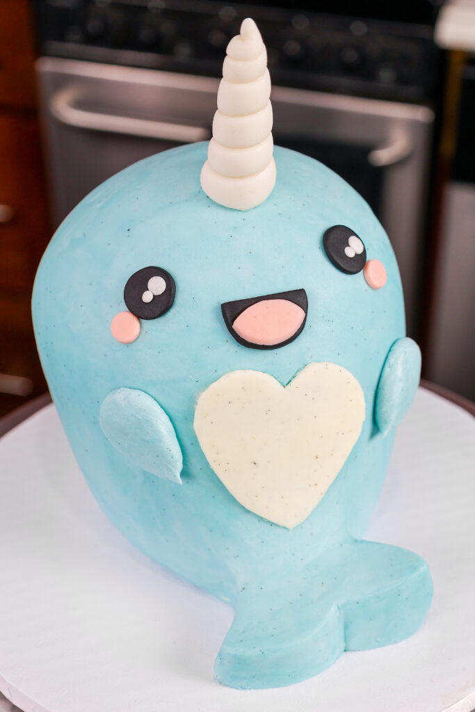 image of an adorable narwhal cake made with buttercream