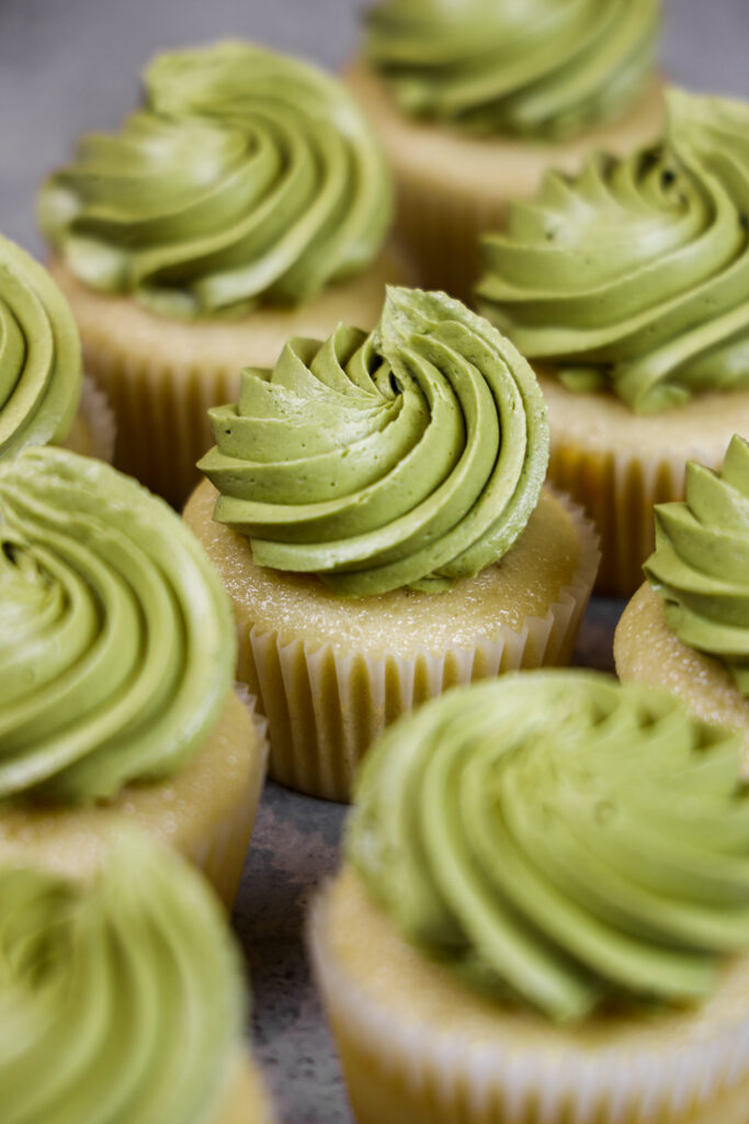 image of vanilla cupcakes frosted with a super smooth, delicious matcha buttercream frosting