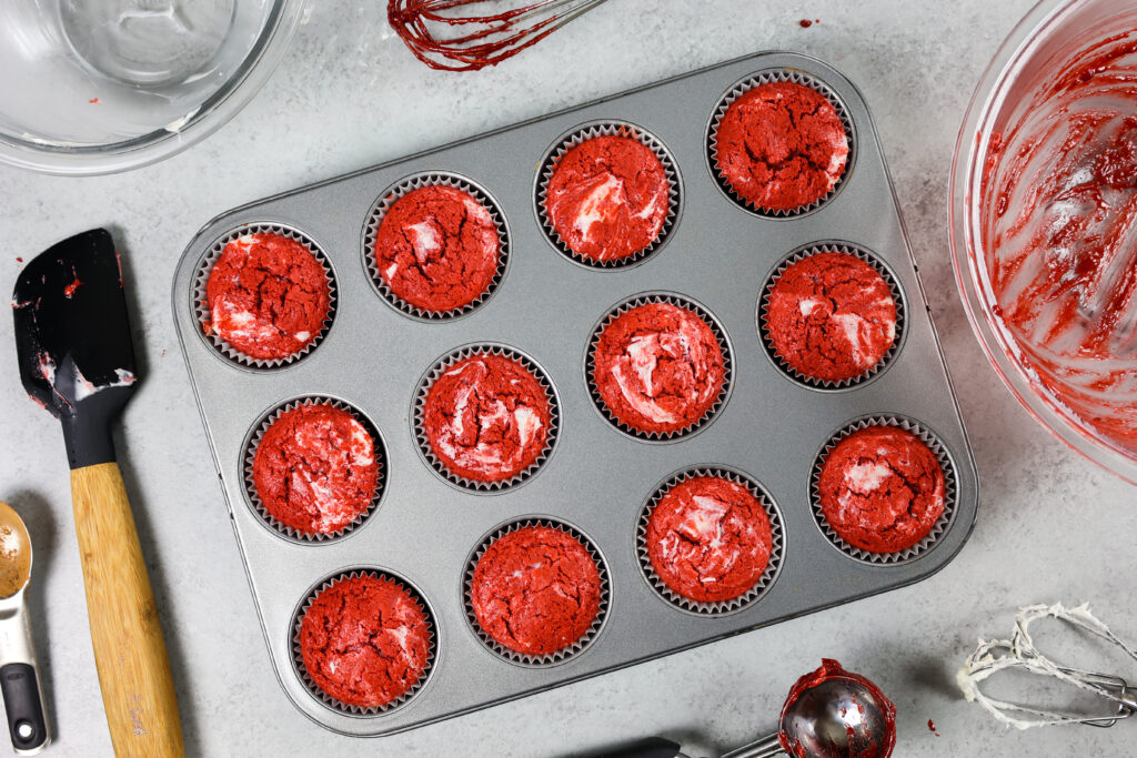 image of red velvet muffins marbled with a cream cheese filling
