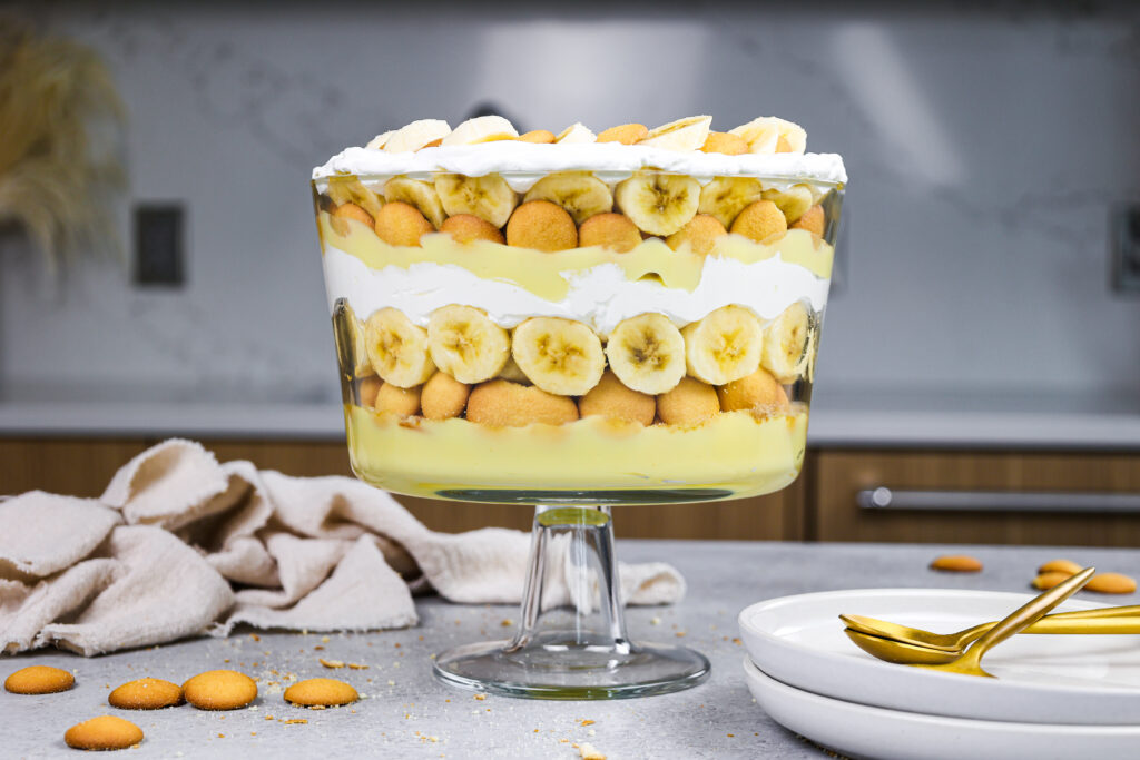 image of banana pudding trifle that's been layered in an 8 inch trifle dish