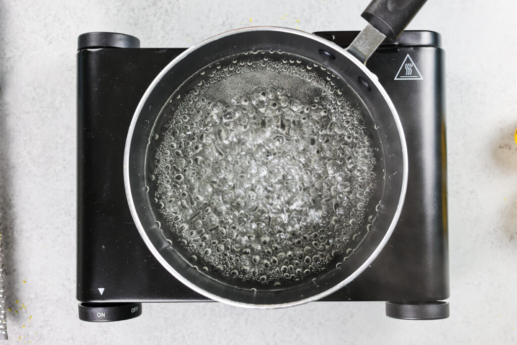 image of simple syrup being brought to a boil to dissolve the sugar