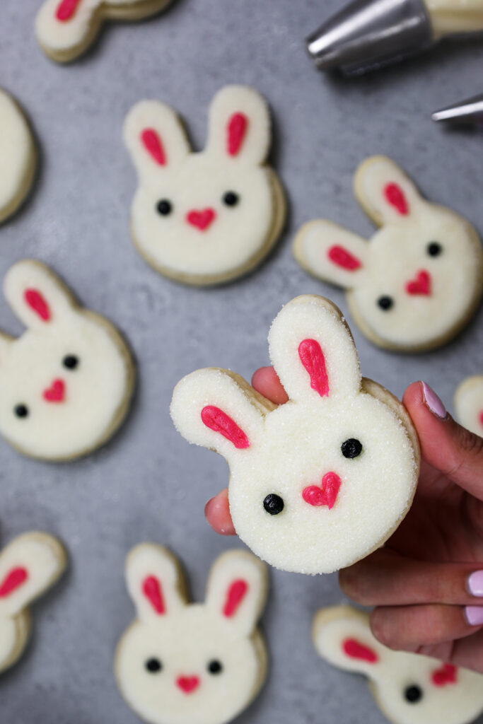 image of a rabbit cookie frosted with buttercream frosting to look just like a bunny rabbit's face