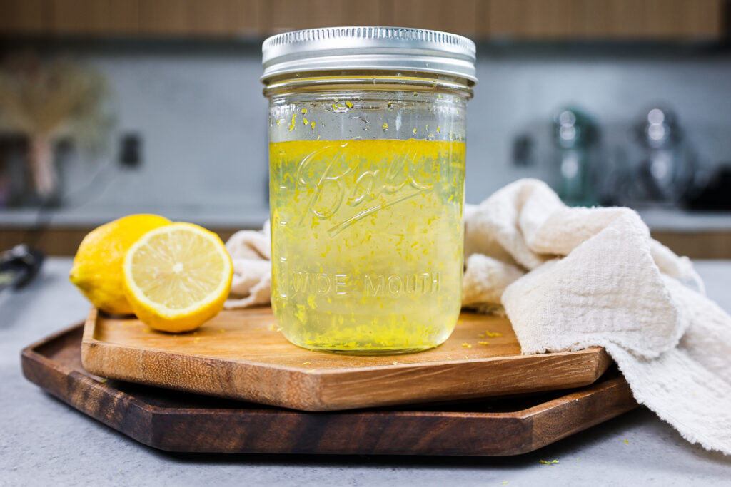 image of lemon simple syrup stored in a mason jar for easy storage