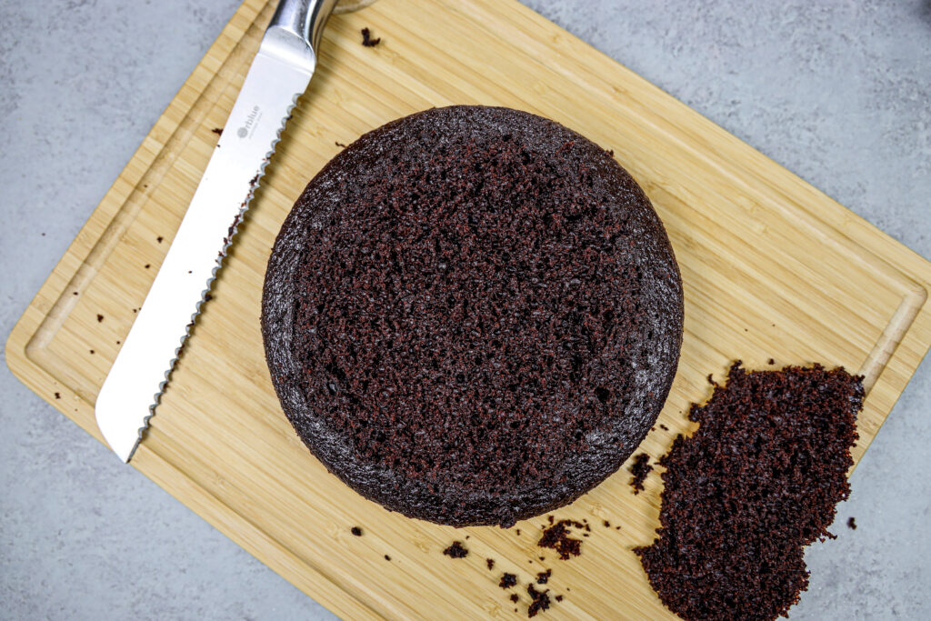 image of a moist chocolate cake layer that's been leveled with a serrated knife to make the cake easier to stack
