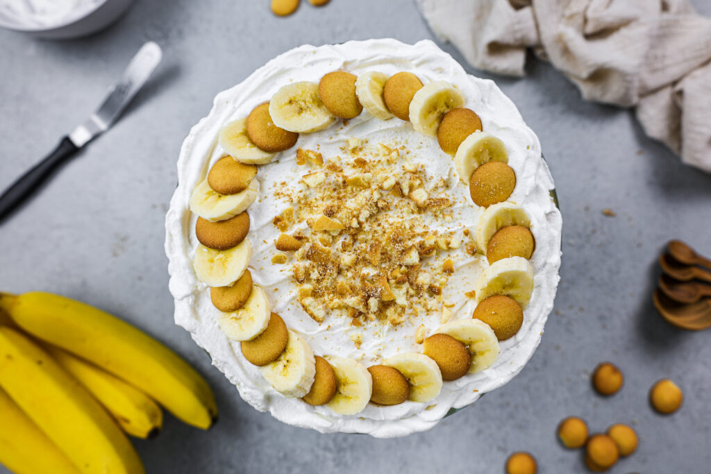 image of a banana pudding trifle made and decorated with fresh banana slices and mini nilla wafers