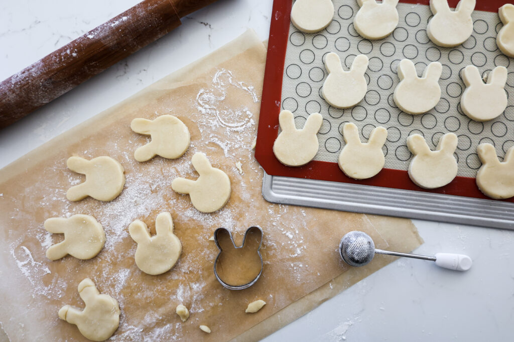 image of cute easter bunny cookies being cut out and ready to be baked