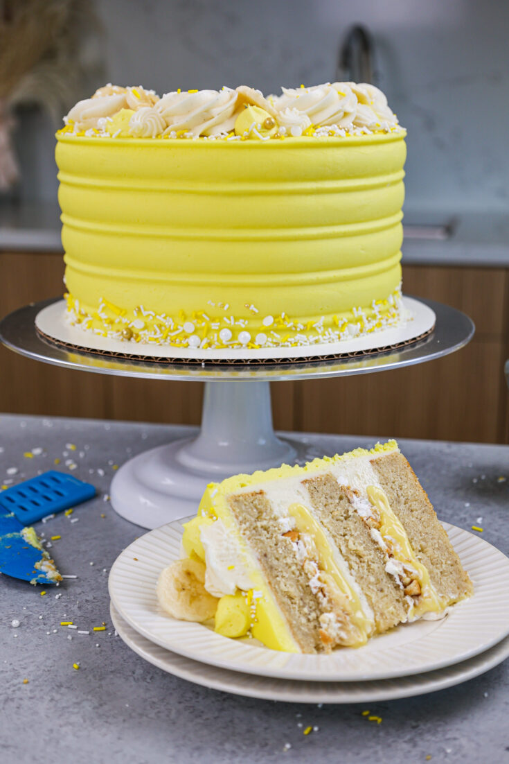 image of a banana pudding layer cake that's been cut into to show it's delicious banana pudding filling