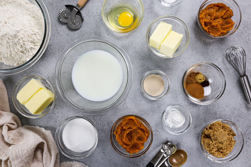 image of ingredients laid out to make pumpkin pie cinnamon rolls