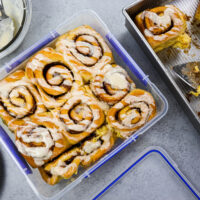 image of pumpkin pie cinnamon rolls that have been place in an airtight container to be frozen and eaten later
