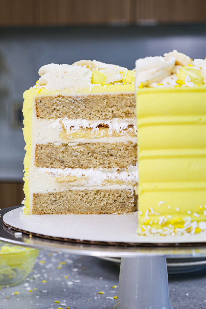 image of a cross section of a banana pudding cake showing it's layers of banana cake and banana pudding filling