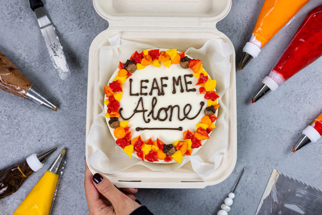 image of a cute bento cake decorated for Fall that says leaf me alone on top