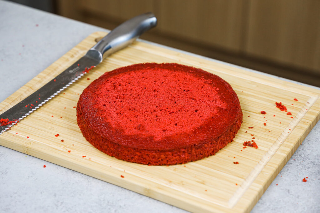 image of an 8 inch red velvet cake layer that's been leveled with a serrated knife
