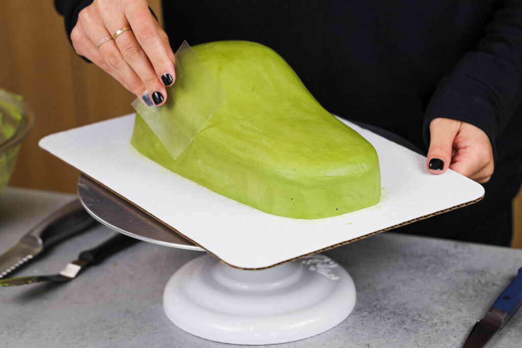 image of green buttercream frosting being smoothed