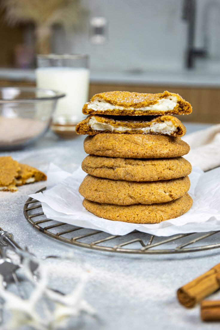 image of pumpkin cheesecake filled cookies stacked on top of one another